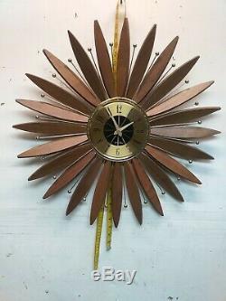 MCM Seth Thomas Intrigue Sunflower Starburst Walnut/Brass Clock. New Movement